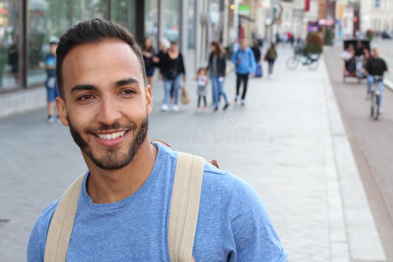 Cute ethnic bearded man smiling outdoors stock photography