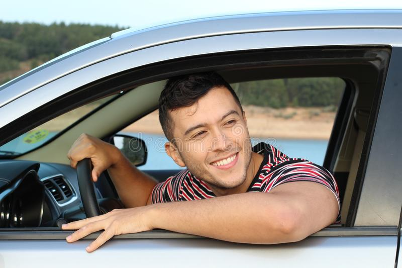Cute ethnic driver looking away stock photography