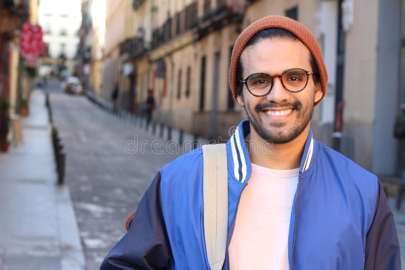 Cute ethnic hipster wearing eyeglasses and hat royalty free stock photo
