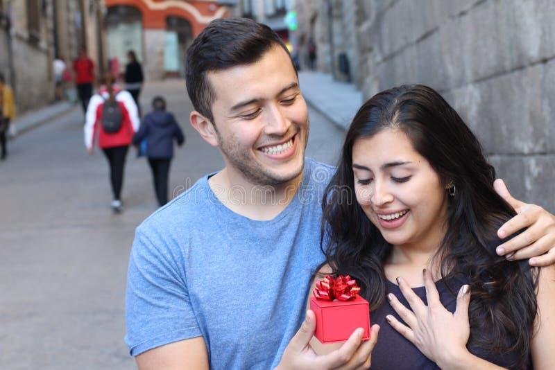 Cute ethnic man proposing outdoors. Cute ethnic men proposing outdoors stock photo
