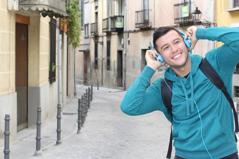 Cute ethnic young male dancing to the beat outdoors royalty free stock photo