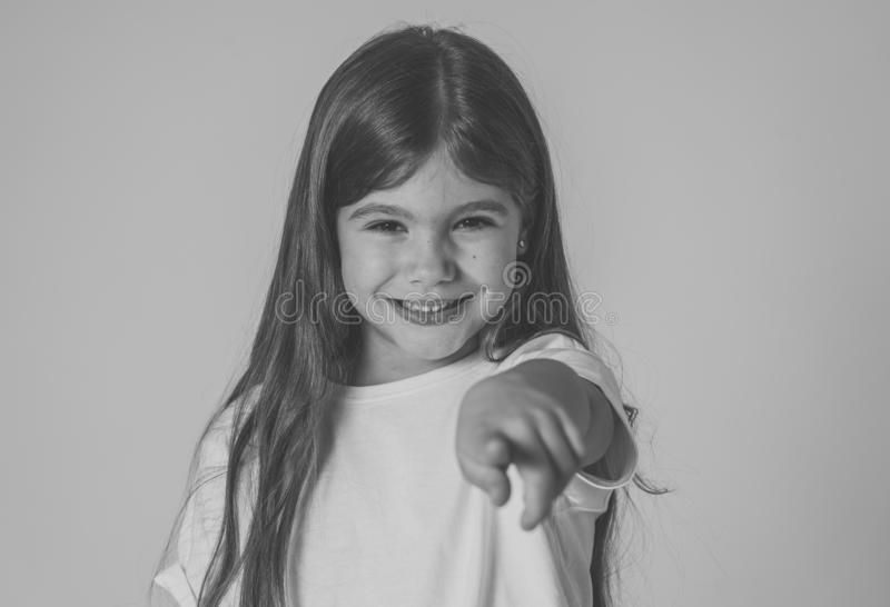 Young beautiful happy, shocked,surprised girl pointing out. Human emotions and facial expression. Cute excited, funny, cheerful young kid with happy and royalty free stock image