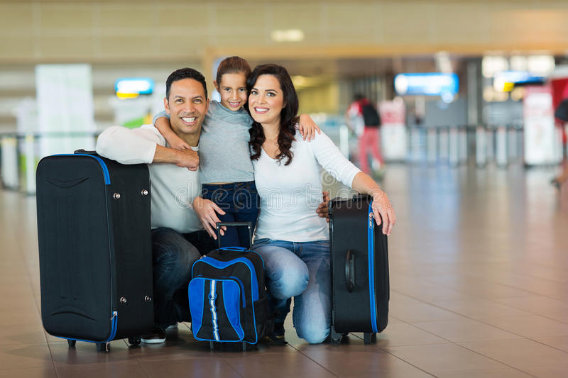Cute family airport. Cute family portrait at airport stock photo