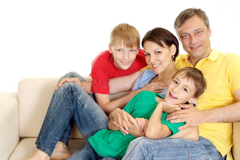 Cute family in bright T-shirts royalty free stock photo