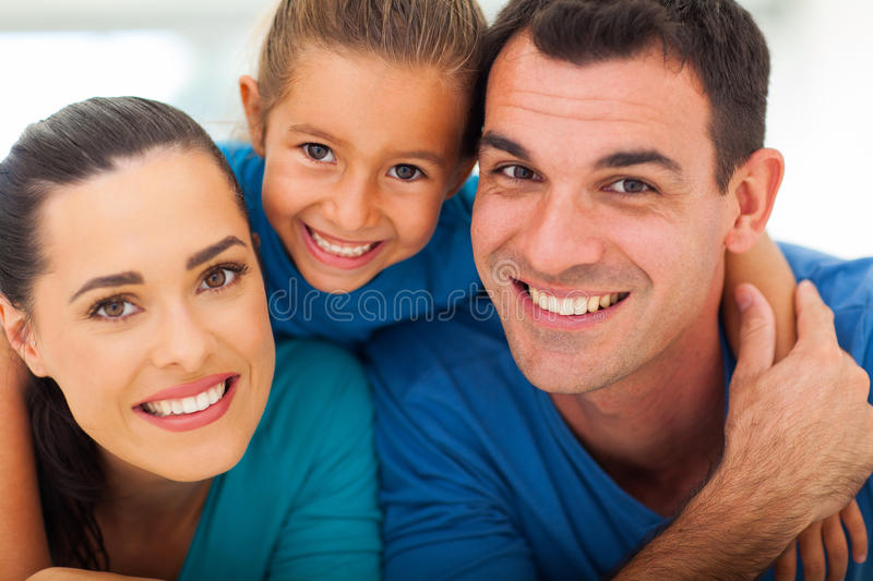 Cute family closeup. Cute family of three face closeup portrait at home royalty free stock images