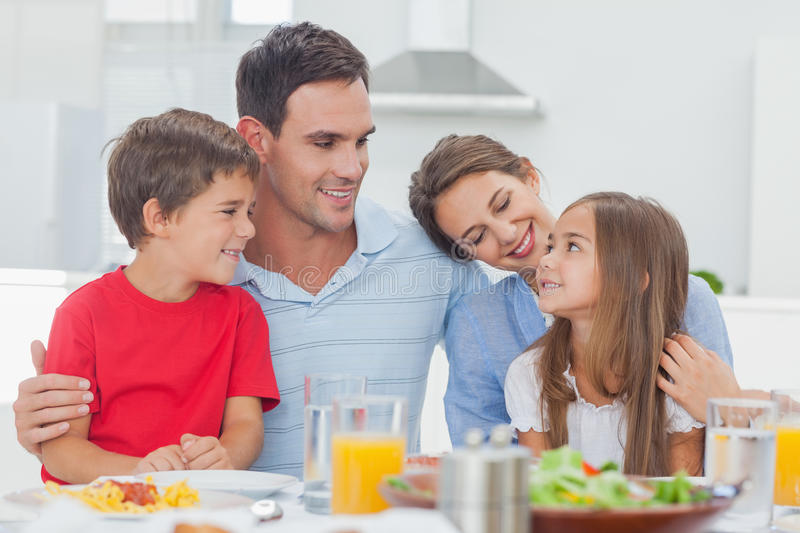 Cute family during the dinner. At the table at home royalty free stock photography