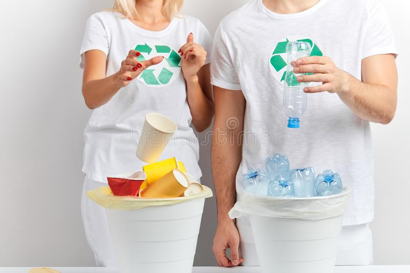 Cute family sorting rubbish at home. Close up cropped photo. isolated white background, studio shot,job, profession, occupation, pastime stock image