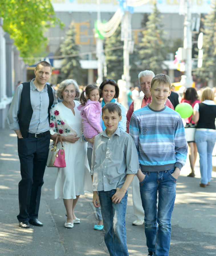 Cute family at town. Portrait of a cute family at town stock photo