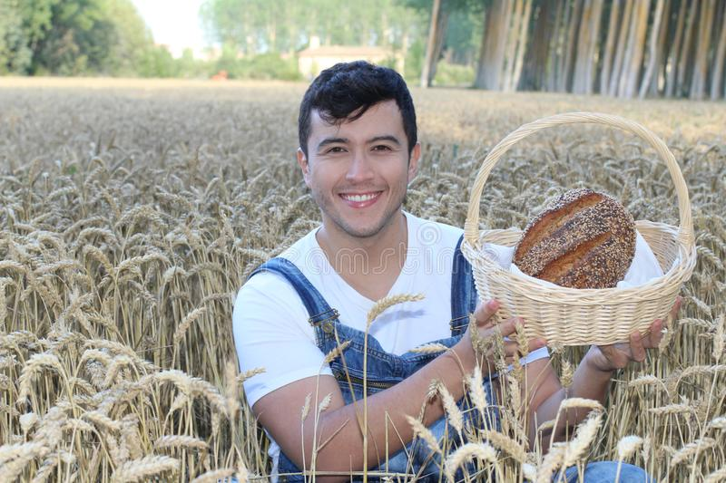 Cute farmer holding artisan bread stock photos