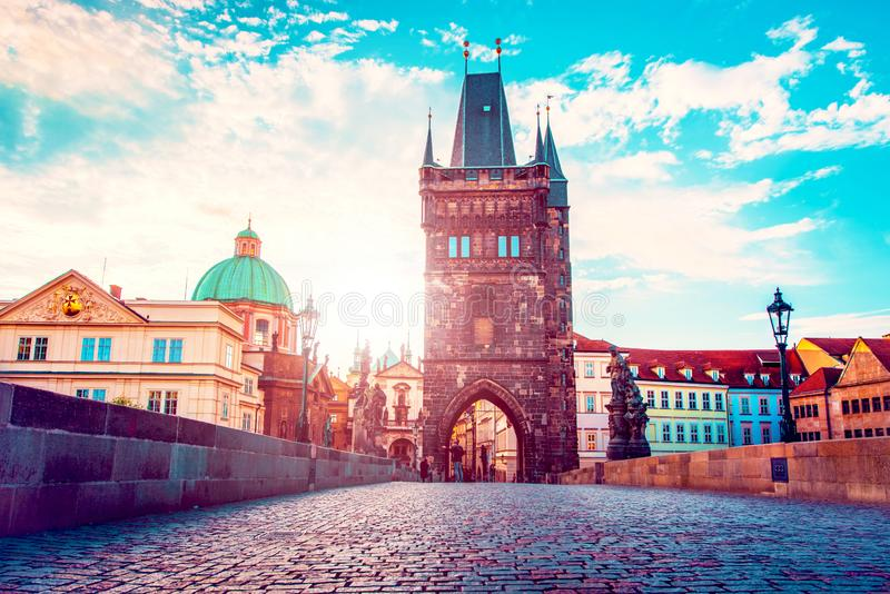 Cute fascinating mystical landscape with arch-tower on Charles Bridge in an old city in Prague, Czech Republic at dawn. amazing royalty free stock image