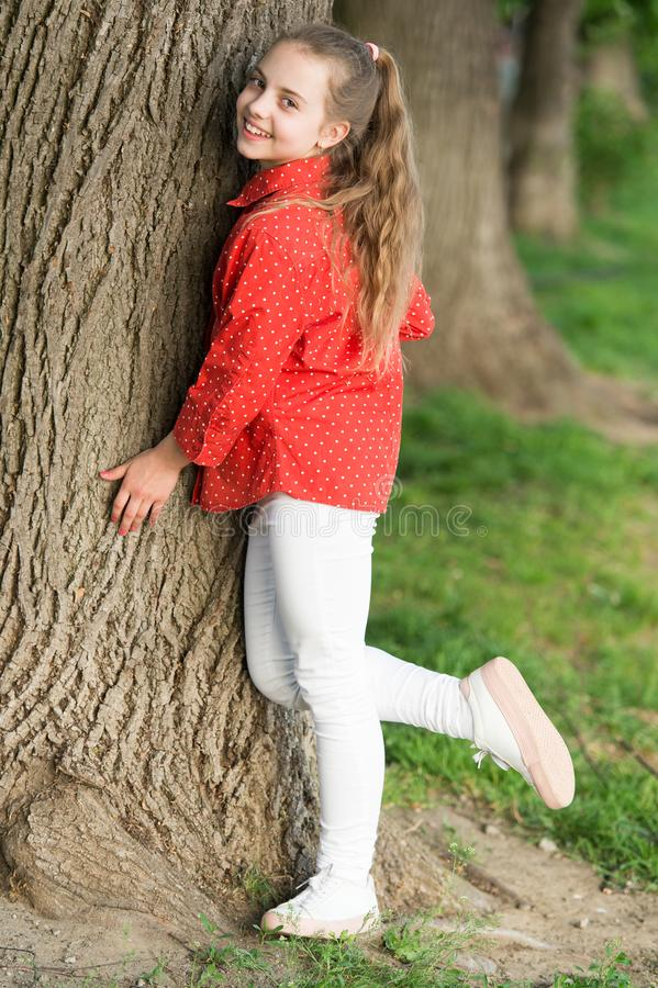 She is really cute. Fashion little lady. Fashionable child in casual fashion style at tree. Adorable girl of fashion in. Casual wear on summer day. Fashion look stock image