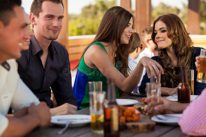Cute female friends gossiping royalty free stock image