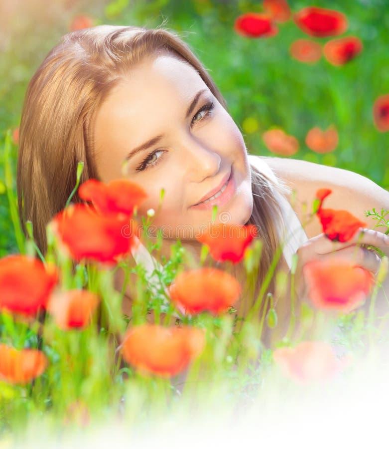 Cute female on poppy field royalty free stock photo
