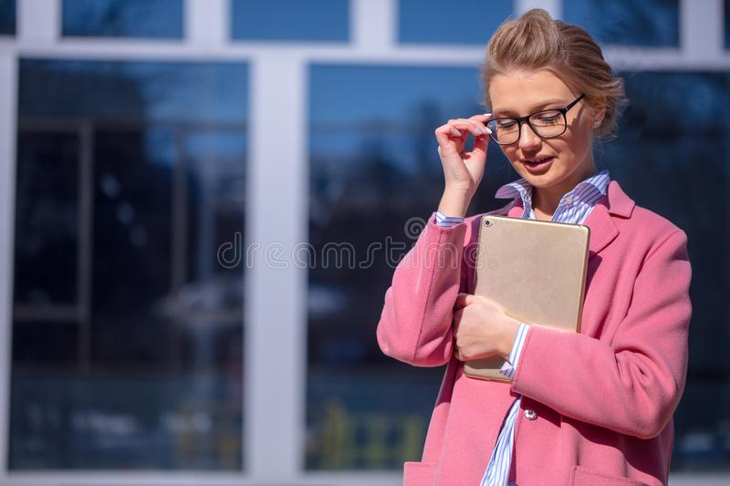 Cute female student standing in front of the university royalty free stock photos