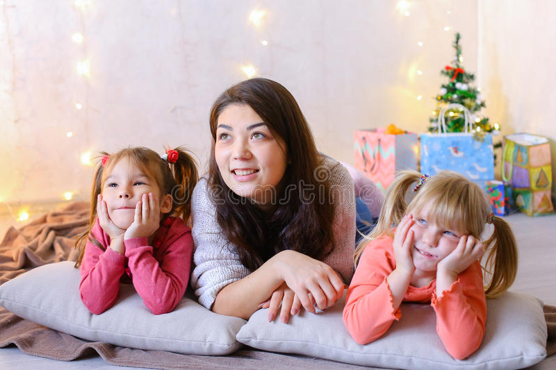 Cute female and two little girls children, posing for camera and stock photos