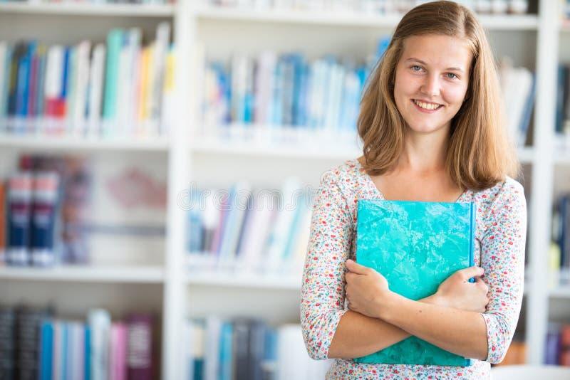 Cute female university/highschool student stock photography