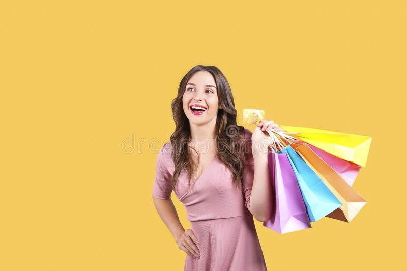 Cute female with wavy hair posing over bright colorful isolated background. stock images