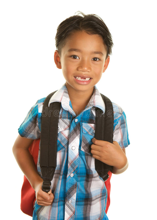 Cute Filipino Boy on White Background with Backpack. A Filipino boy on a white background with a backpack and nice shirt for school. He is smiling and has a gap stock images