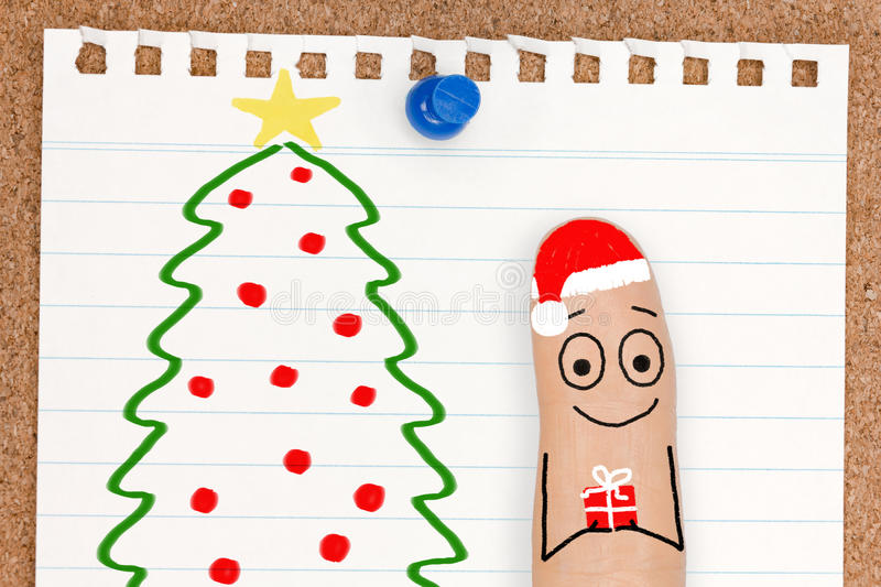 Cute Finger Face Person with Gift by Christmas Tree stock images