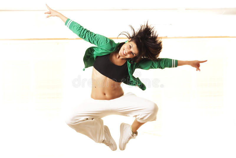 Cute fit girl jumping stock photos