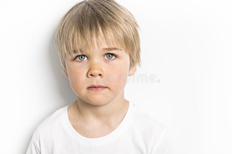 A cute five year old boy studio portrait on white background royalty free stock image