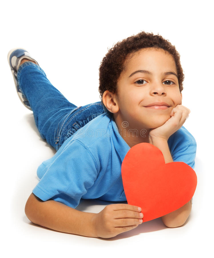 Cute five years old boy with heart stock photos