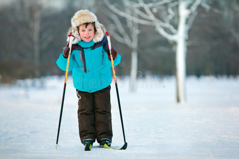 Cute five years old boy skiing on cross stock photo