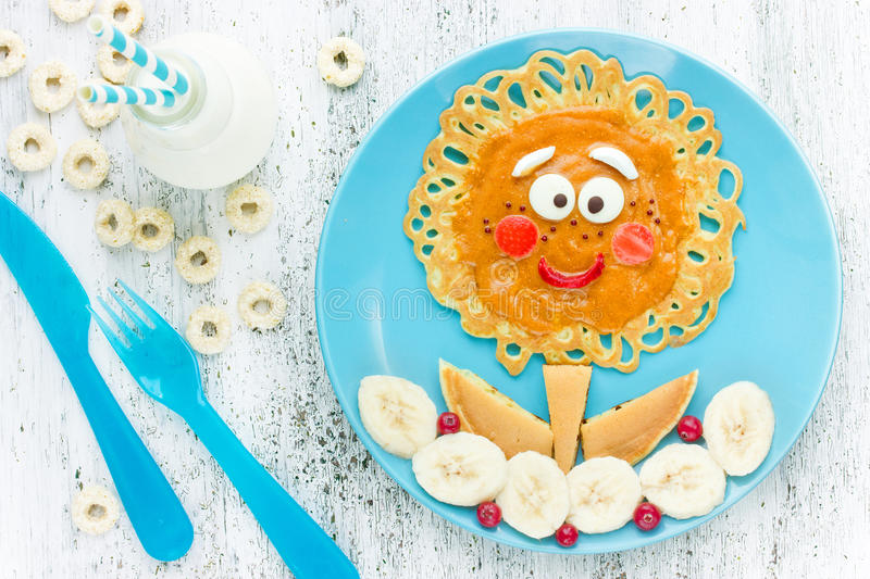 Cute flower pancakes with banana for kids breakfast. Good morning concept. Creative idea for fun children food royalty free stock photo