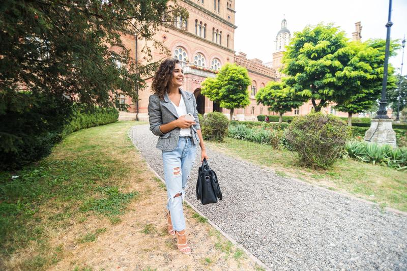 Cute friendly attractive pretty female college student lifestyle mixed race ethnicity royalty free stock images