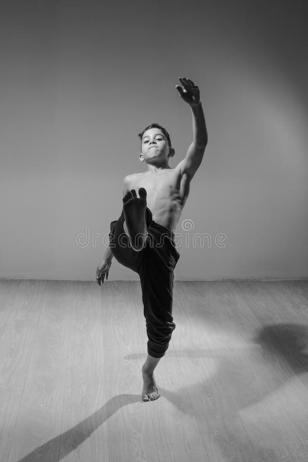 Cute funny boy in dance studio - Young man break dancing. Cute funny boy in dance studio stock images