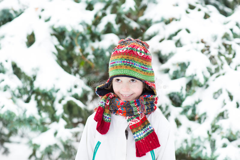 Cute funny child playing in a snowy forest royalty free stock photography