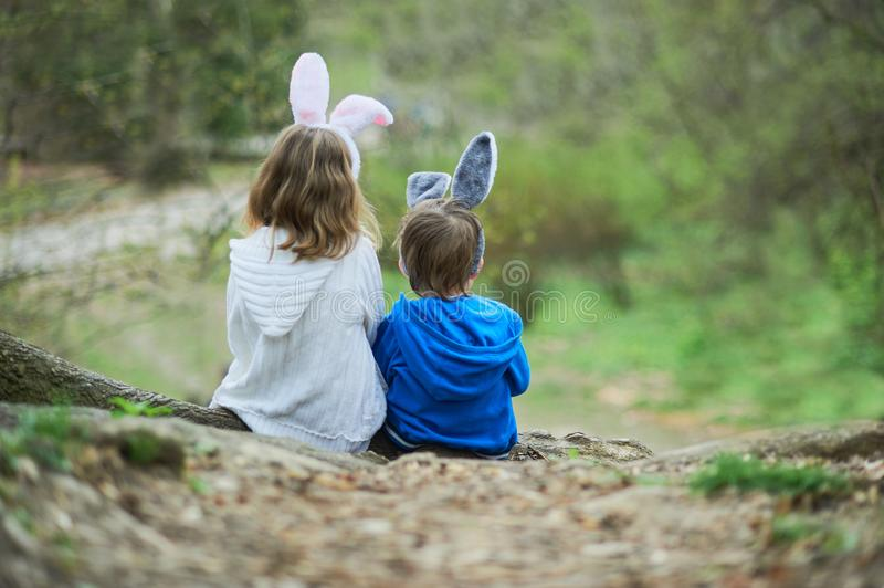 Cute funny girl and boy with Easter eggs at park. easter concept. Children playing with easter eggs on Easter day. Family holiday royalty free stock images