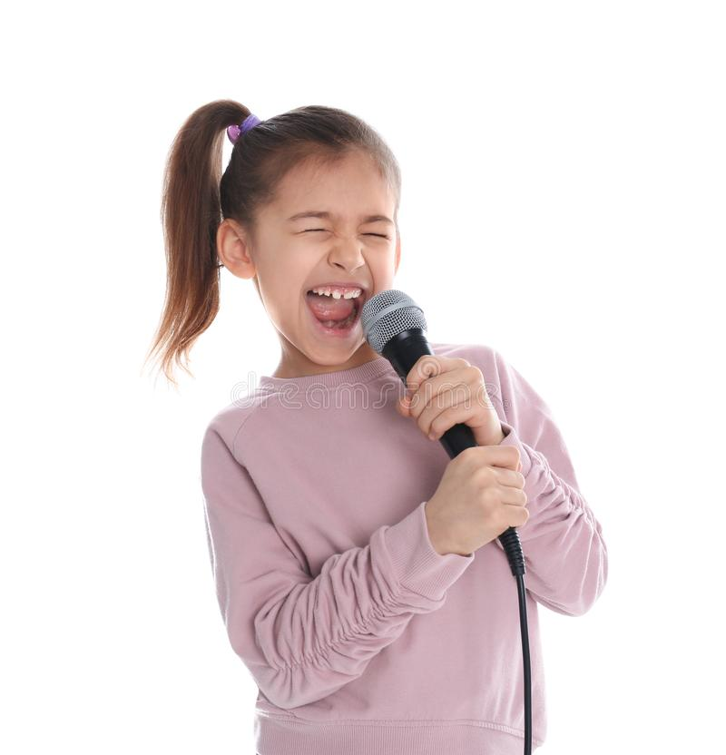 Cute funny girl with microphone stock photo