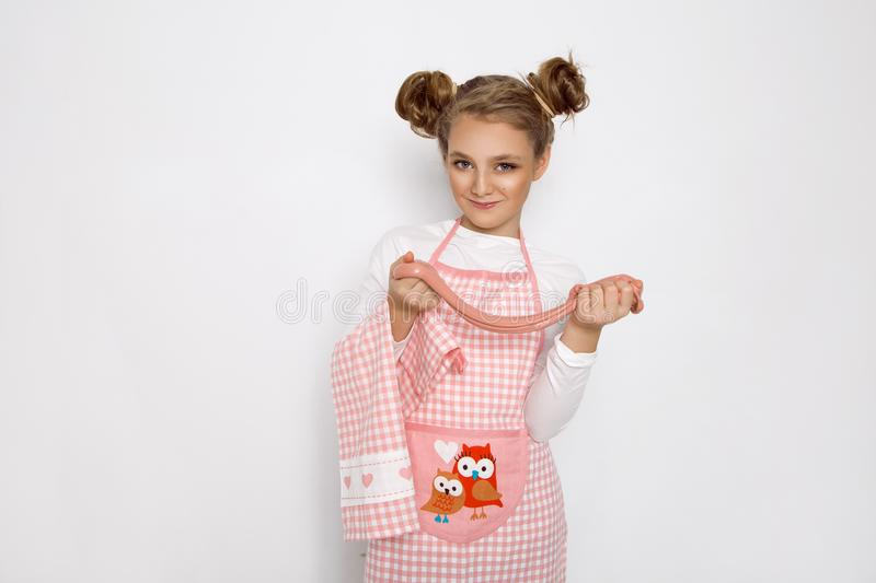 Cute funny girl with slime in the kitchen. The girl cooks and bakes her muffins, makes a cake and slime. royalty free stock photography