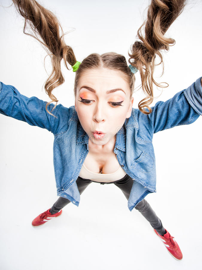 Download Cute Funny Girl With Two Pony Tails - Wide Angle Shot Stock Image - Image: 30668697