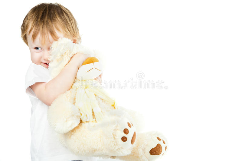Cute funny infant baby girl with big toy bear. Beautiful kid's portrait closeup royalty free stock image