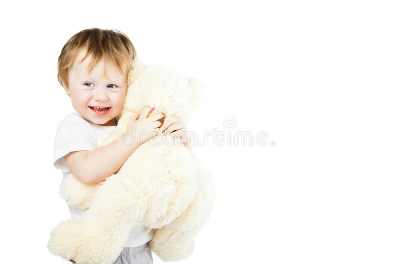 Cute funny infant baby girl with big toy bear. Beautiful kid's portrait closeup stock photo