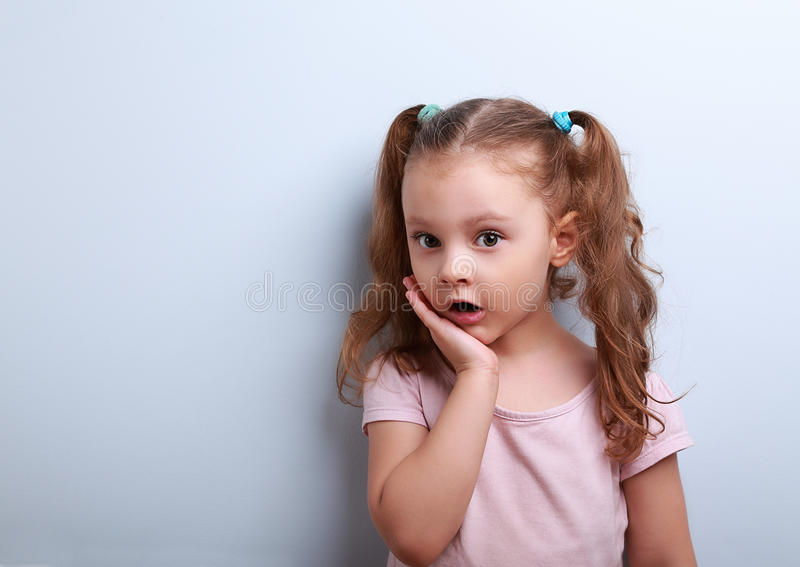 Cute funny kid girl surprising with open mouth stock photo