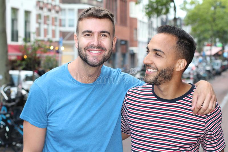 Cute gay couple in the city royalty free stock photos