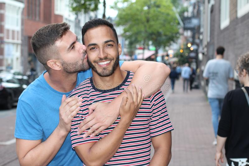 Cute gay couple in the city royalty free stock photography