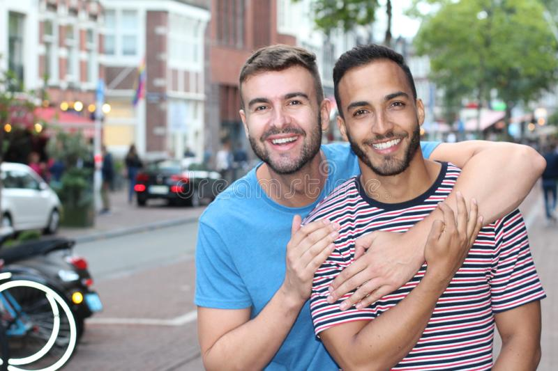 Cute gay couple in the city stock photography
