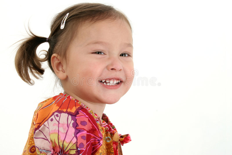 Cute Girl. A portrait of a smiling cute American Japanese girl, on white studio background royalty free stock photo