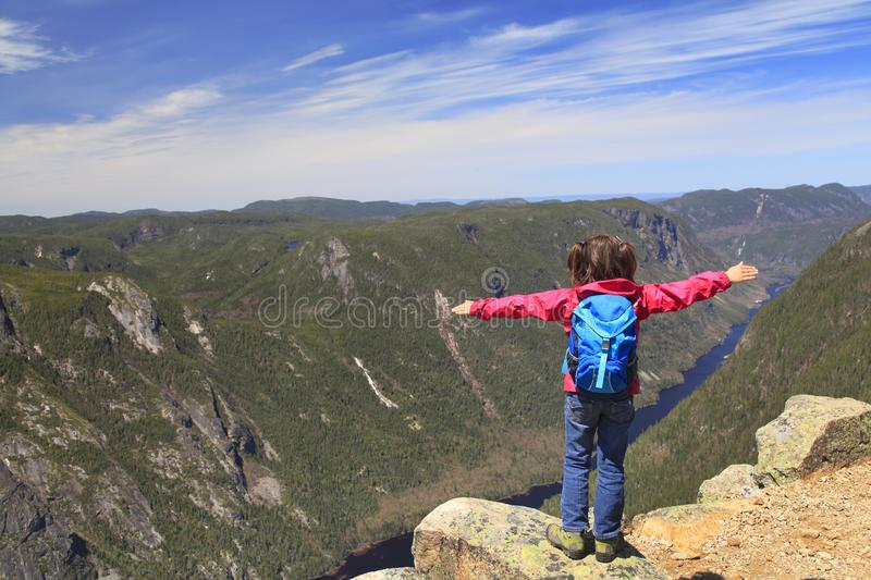 Cute girl admiring the landscape of Malbaie Canyon in Quebec, Canada. Cute girl admiring the landscape of Malbaie Canyon and river from the summit of Acropoles royalty free stock photos