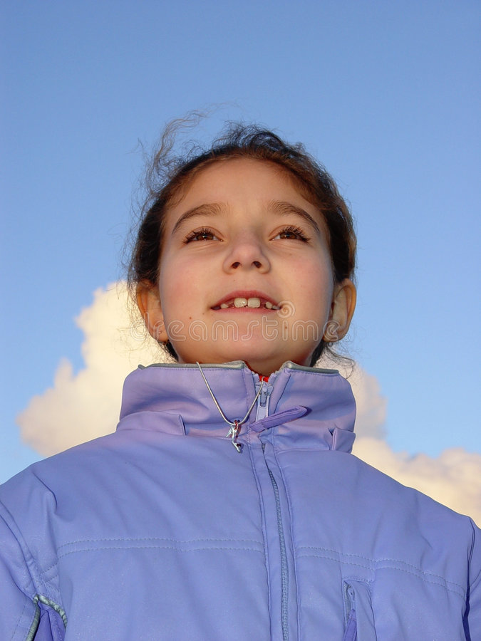 Cute girl against the sky royalty free stock image