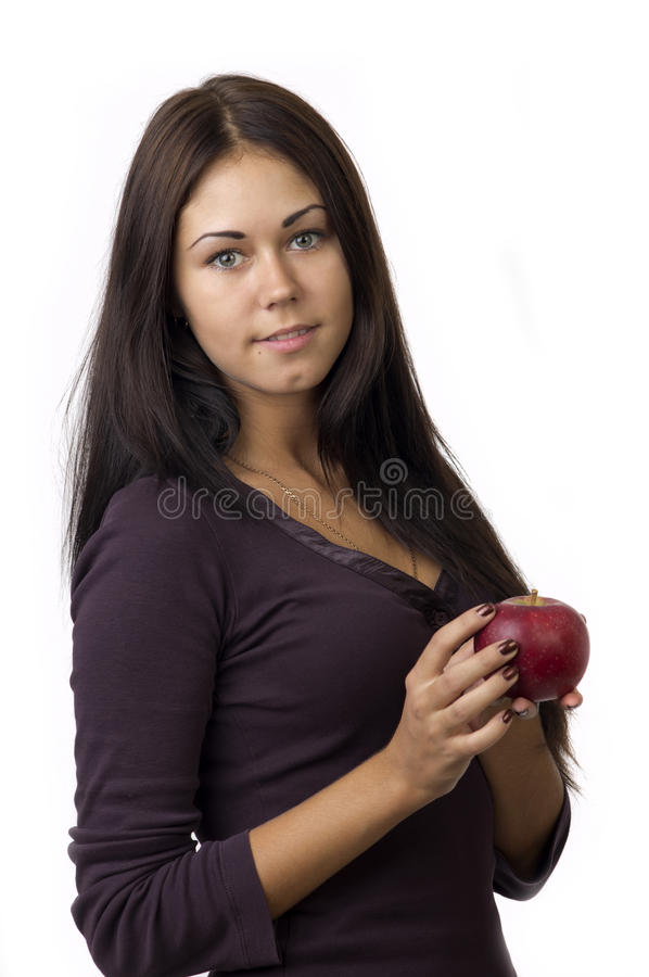 Cute Girl With An Apple In Your Hands Royalty Free Stock Photos