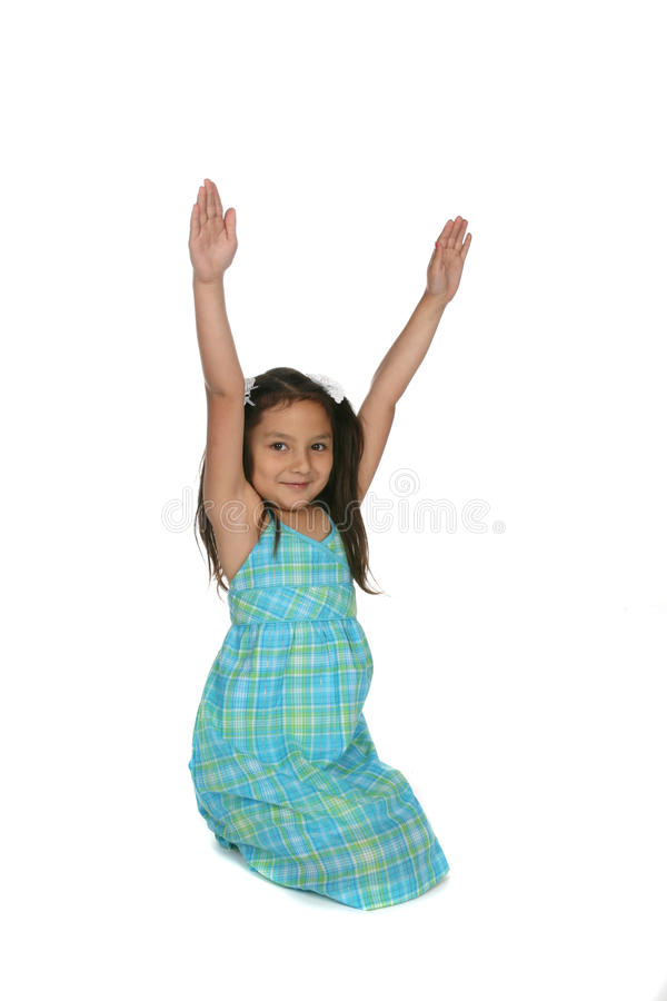 Cute girl with arms raised in victory celebration
