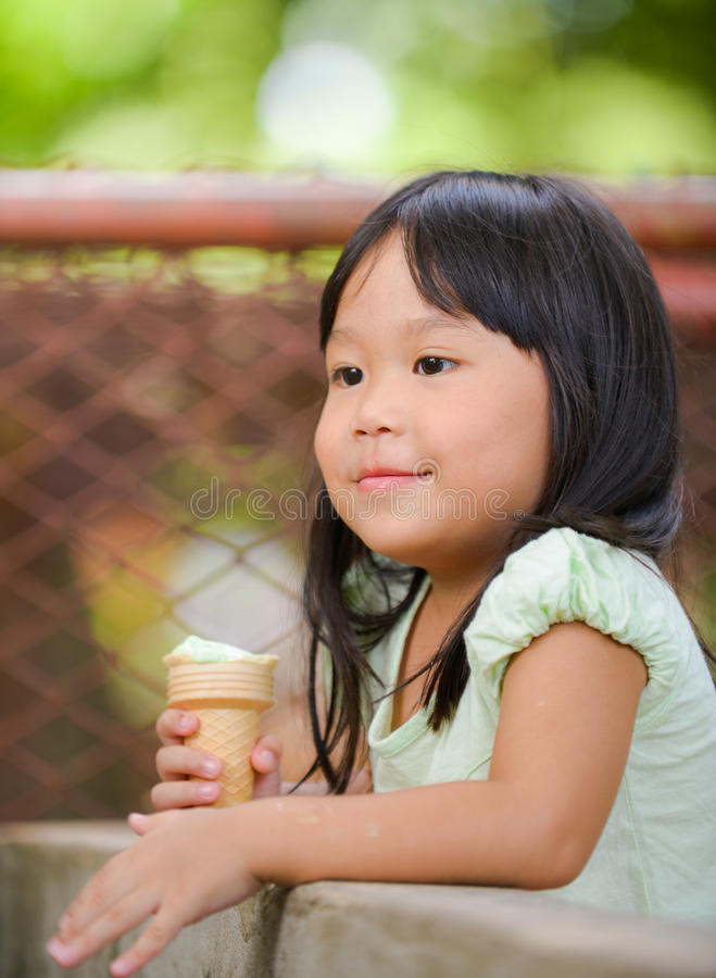 Cute girl Asian like to eat ice-cream. Everyday royalty free stock image
