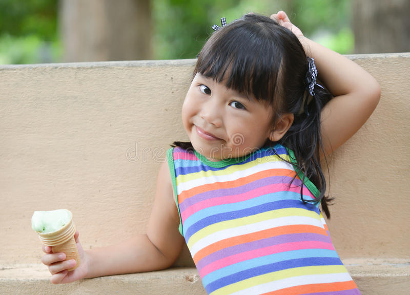 Cute girl Asian like to eat ice-cream royalty free stock images