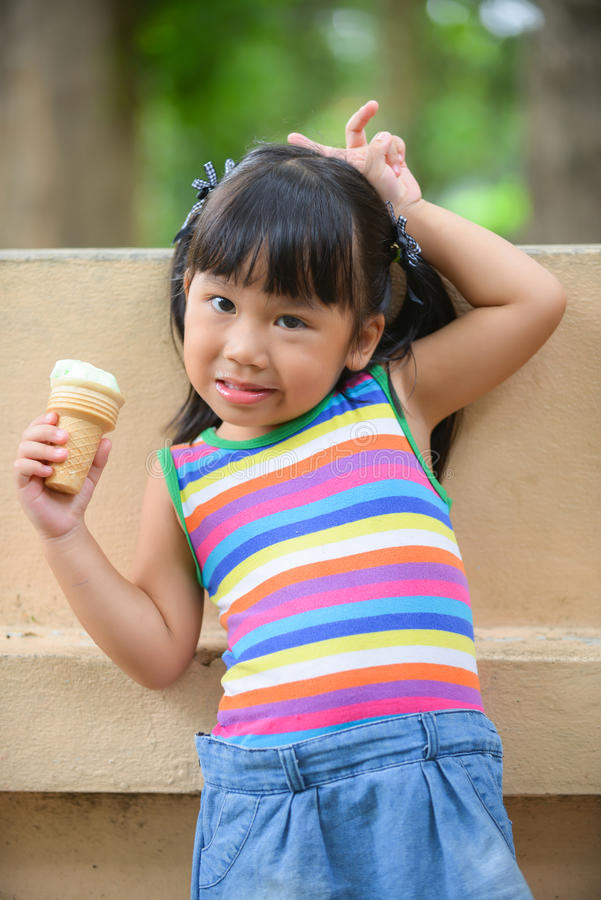 Cute girl Asian like to eat ice-cream. Very much stock photos
