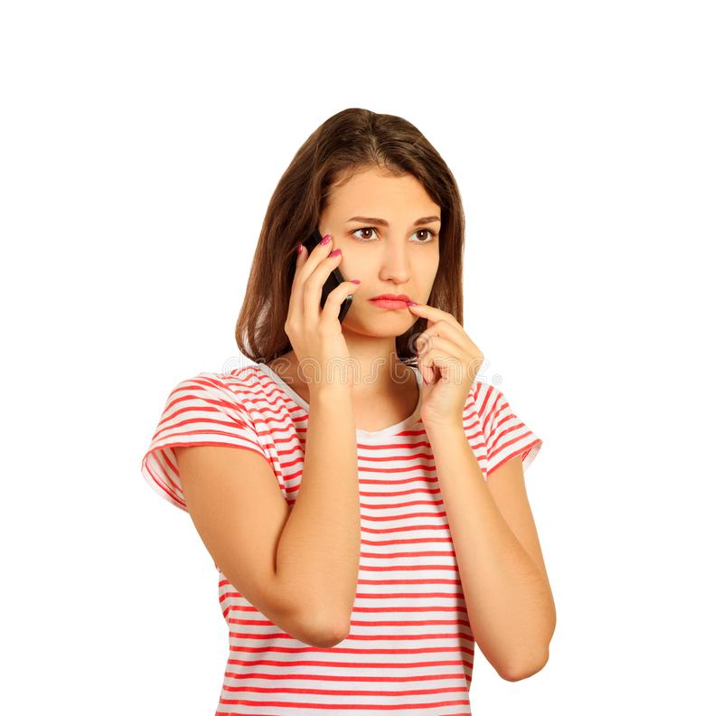 Cute girl with an awkward phone call, gossip with her friend on the mobile phone. emotional girl isolated on white background royalty free stock photos